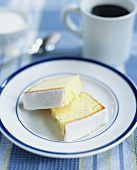 Two Pieces of Lemon Pound Cake on a Plate; Coffee