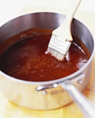 Barbecue Sauce in a Pan with Brush
