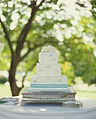 Three Tiered Wedding Cake on Outdoor Table