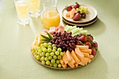Fruit Platter with Orange Juice and Serving Plates