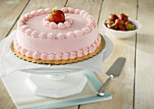 Whole Cake with Strawberry Frosting, Topped with a Strawberry
