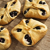 Homemade Blueberry and Cream Cheese Pastries on Wood