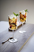 Two Stem Glasses of Fruit Salad with Mint Garnish