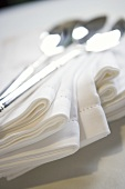 Stack of Cloth Napkins with Spoons