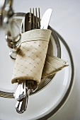 Place Setting with Utensils in a Cloth Napkin