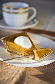 Slice of Pumpkin Pie with Piece on Fork