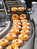Glazed Donuts on Conveyor Belt