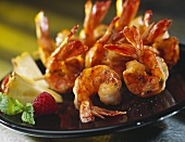 Skewered Shrimp on a Black Plate