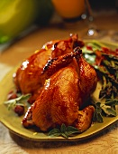 Two Small Roast Chickens on a Platter with Asparagus
