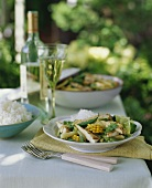 Grilled Chicken and Vegetables with Rice on Outdoor Table
