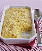Corn Pudding in Serving Dish with Scoop Removed