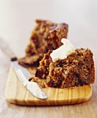 Apple Cake with Butter on Cutting Board