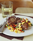 Pork Chops with Mango Salsa on a Plate with Fork and Knife