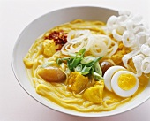 Fish curry with vegetables, eggs & deep-fried glass noodles