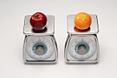 Two Scales; One with an Apple and One with an Orange