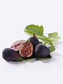 Fresh Figs on Leaves; One Halved