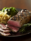 Sliced Grilled New York Steak with Fries
