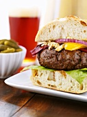Hearty Pub Burger; Bowl of Pickles