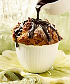 Pouring Chocolate Sauce Over Individual Bread Pudding