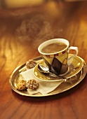 Steaming Cup of Coffee with Amaretto Cookies