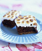 Two S'mores Brownies on a Blue Plate