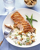 Salmon with Piece on Fork and Cashew Rice