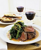 Grilled Steak with Broccoli Rabe and Glass of Red Wine