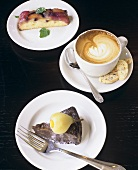 Slice of Chocolate Cake with Pear, Cappuccino and Slice of Fruit Cake