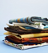 Pile of Various Folded Cloth Napkins