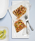 Two Pieces of Grilled Salmon with Onions and Peppers