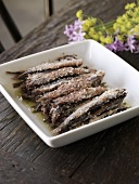 Sardines in a Serving Bowl on a Wooden Table