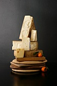 Various Cheese with Tangerines on Breadboards