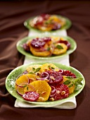 Three Plates of Citrus Salads with Red Onion