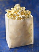 Bag of Popcorn on a Blue Background