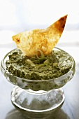 Chip Dipped in a Bowl of Spinach Dip