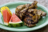 Grilled Chicken Pieces with Watermelon and Corn on the Cob