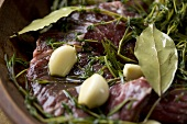 Skirt Steak Marinating in Fresh Herbs and Garlic