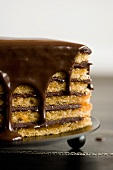 Chocolate Icing Dripping Over Yellow Layer Cake