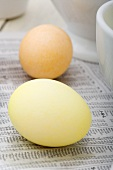 Two Dyed Easter Eggs; Yellow and Orange