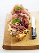 Open Meat Sandwich on a Cutting Board