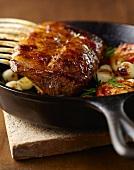 Roast Lamb Rack and Vegetables in Skillet