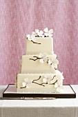 White Fondant Wedding Cake Decorated with Dogwood Branches
