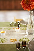 Thanksgiving Dinner Table with Orange Carnation Centerpiece