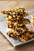 Stack of Spicy Nut Brittle Made with Assorted Nuts