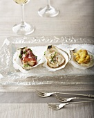 Three Types of Oysters on a Glass Plate