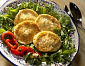 Fried Mozzarella Slices Over Greens