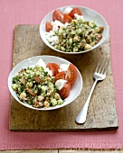 Two Bowls of Tabouleh with Tomato and Cheese Salad