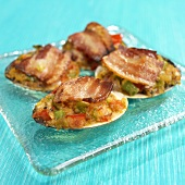 Clams Casino Topped with Bacon on Glass Plate