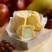 LangresCheese with Wedge Removed; Fresh Fruit