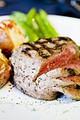 Partially Sliced Grilled Rib Eye; Potatoes and Asparagus
